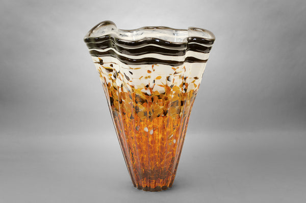 Fluted kaleidoscope vase with amber / topaz and white colors and silver rim