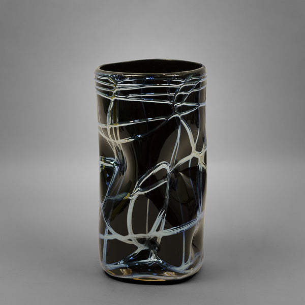 Black Picasso drinking glass with silver swirls