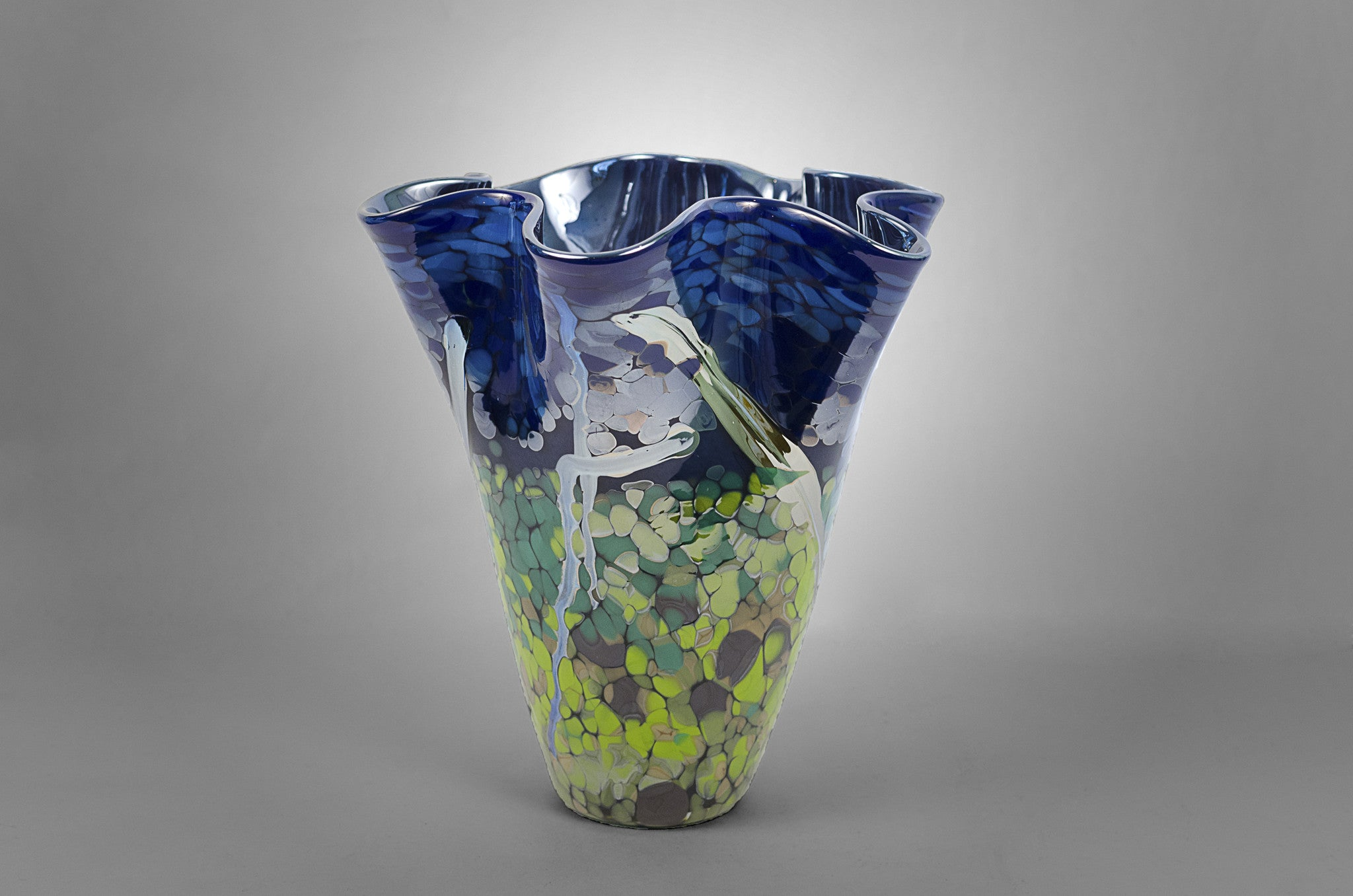 Dark blue hand blown glass fluted nature vase with blue, green and silver