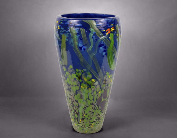 Dark blue hand blown glass tapered nature vase with blue, green, red and silver