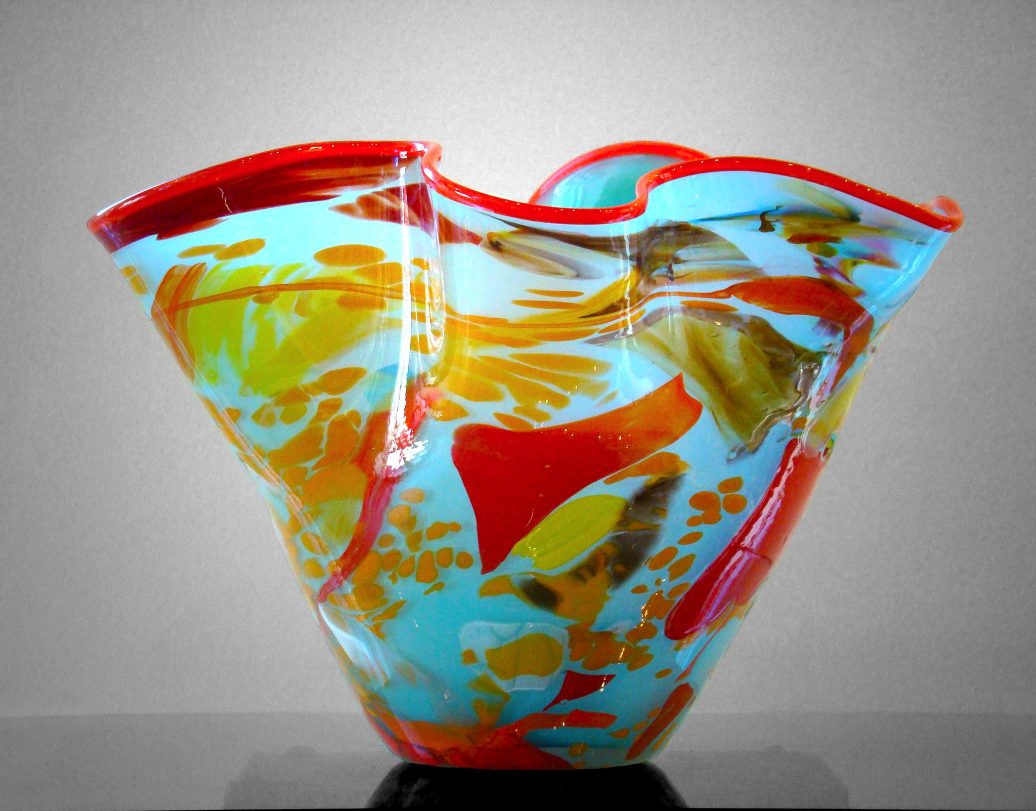 Fluted bowl / vase with broken shards of recycled glass and light blue base color and red rim