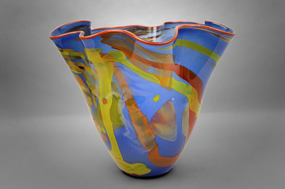 Fluted bowl / vase with broken shards of recycled glass and blue base color and orange rim