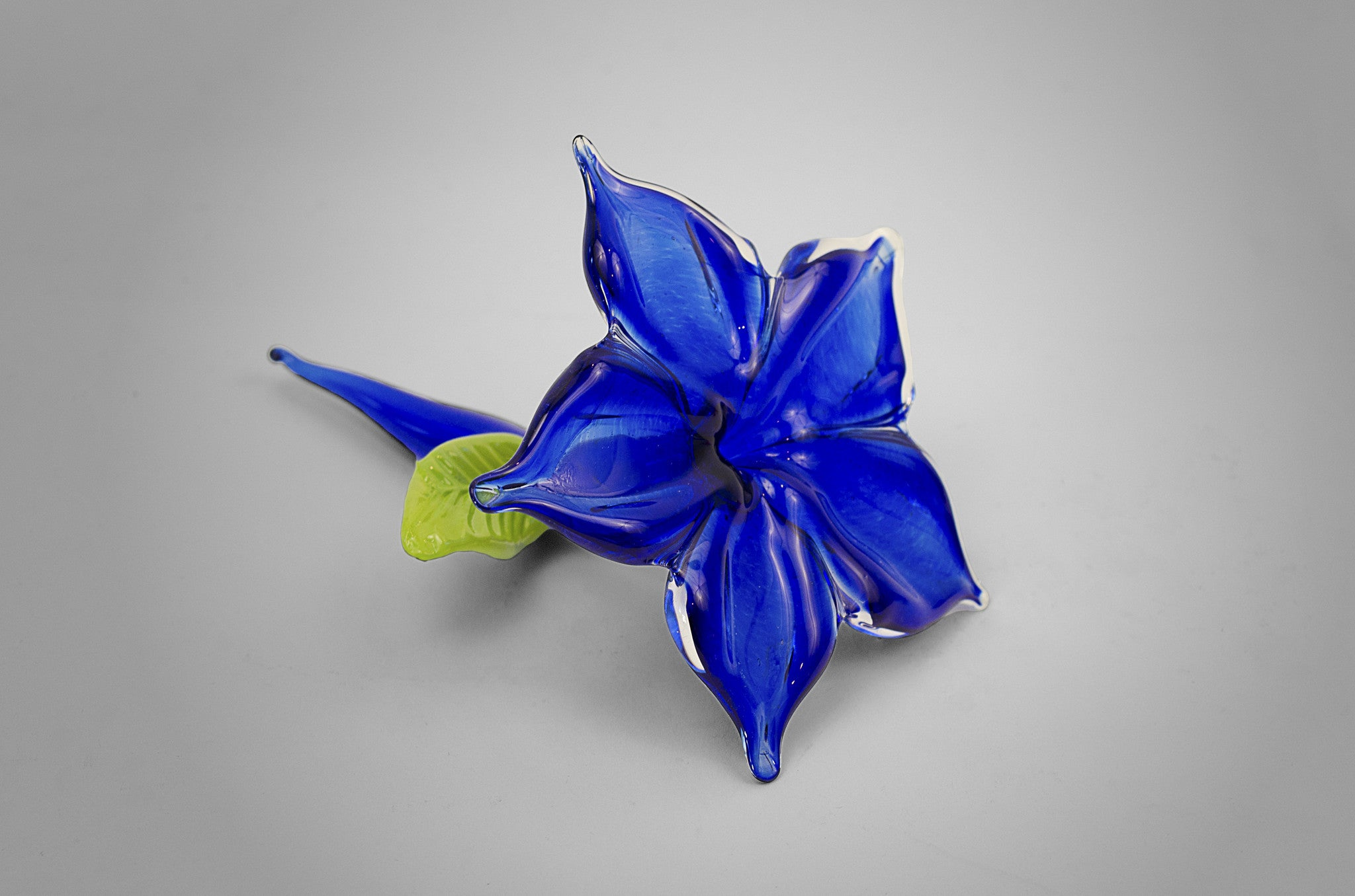 Small unique handmade glass accent flower in cobalt blue color
