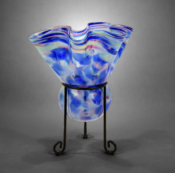 Fluted candleholder blown into metal stand in cool color mix