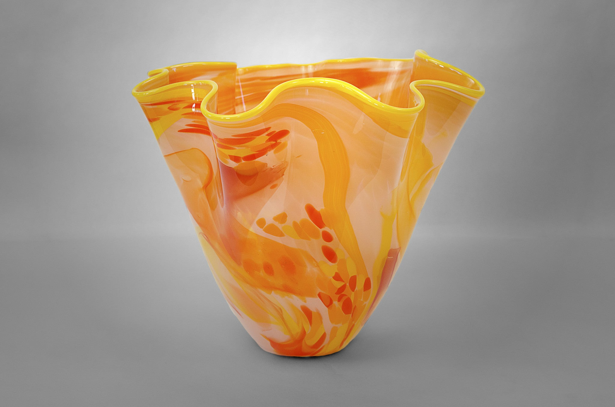 Fluted bowl / vase with broken shards of recycled glass and pink base color and yellow rim