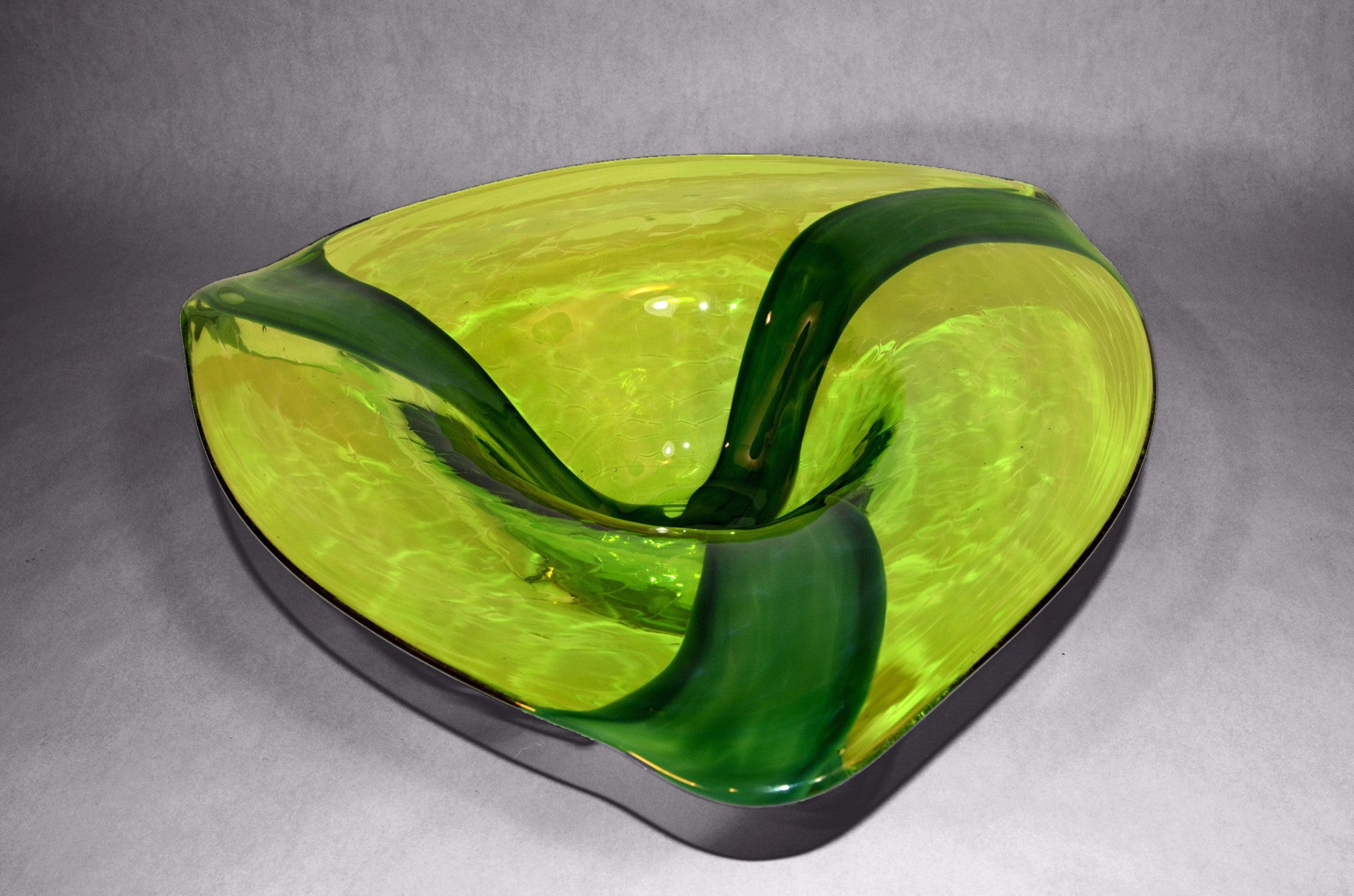 Green triangular shaped murano bowl