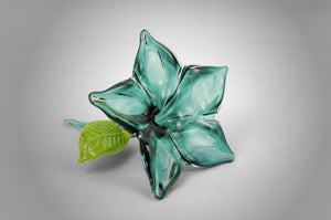 Small unique handmade glass accent flower in lagoon color
