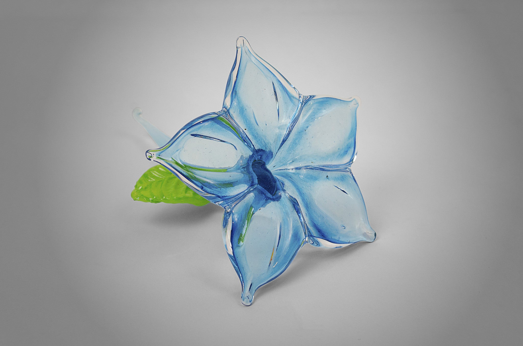 Small unique handmade glass accent flower in light blue color