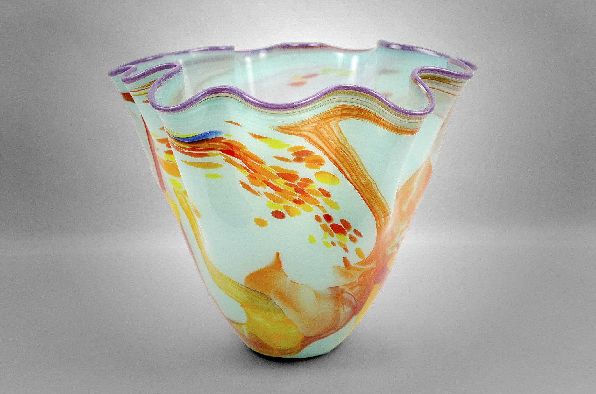 Fluted bowl / vase with broken shards of recycled glass and light blue base color and purple rim