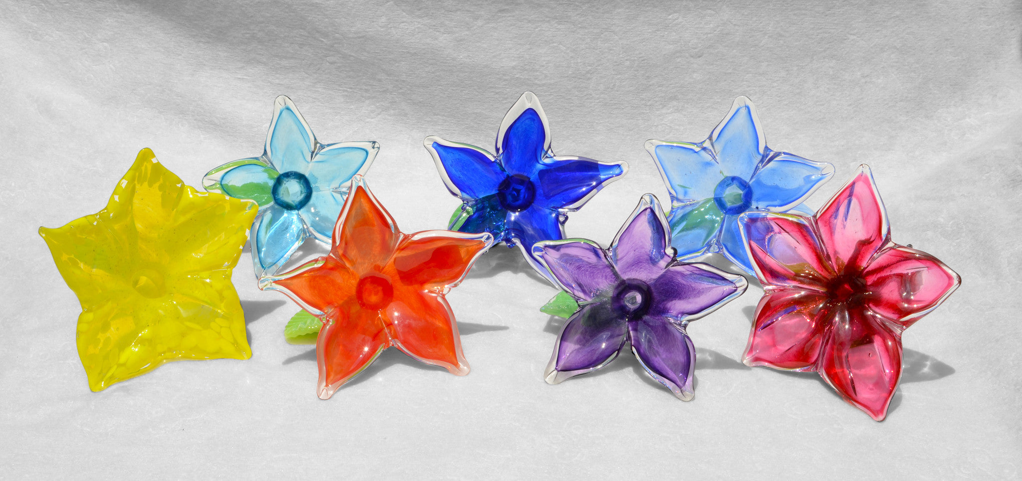 Small unique handmade glass accent flowers in assorted colors