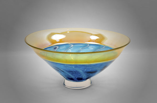Blue and gold bowl with white spiral center
