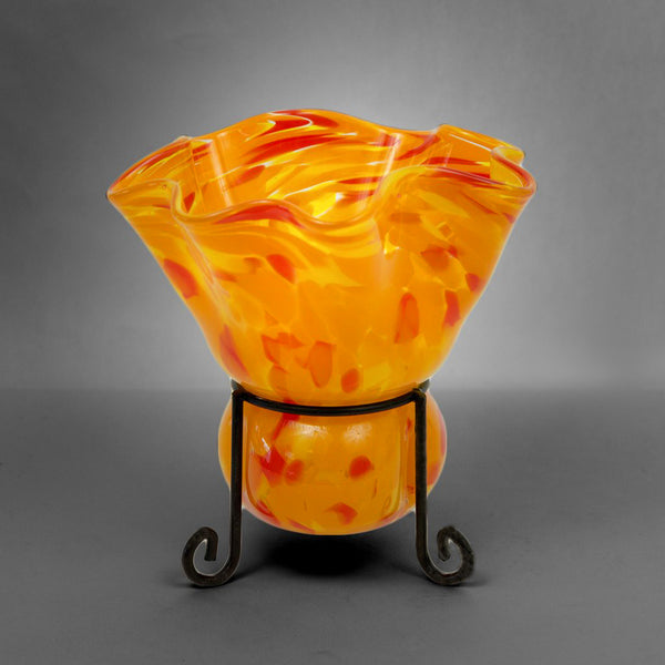 Fluted candleholder blown into metal stand in orange color mix