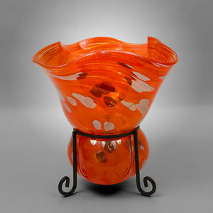 Fluted candleholder blown into metal stand in orange with silver spots - short stand