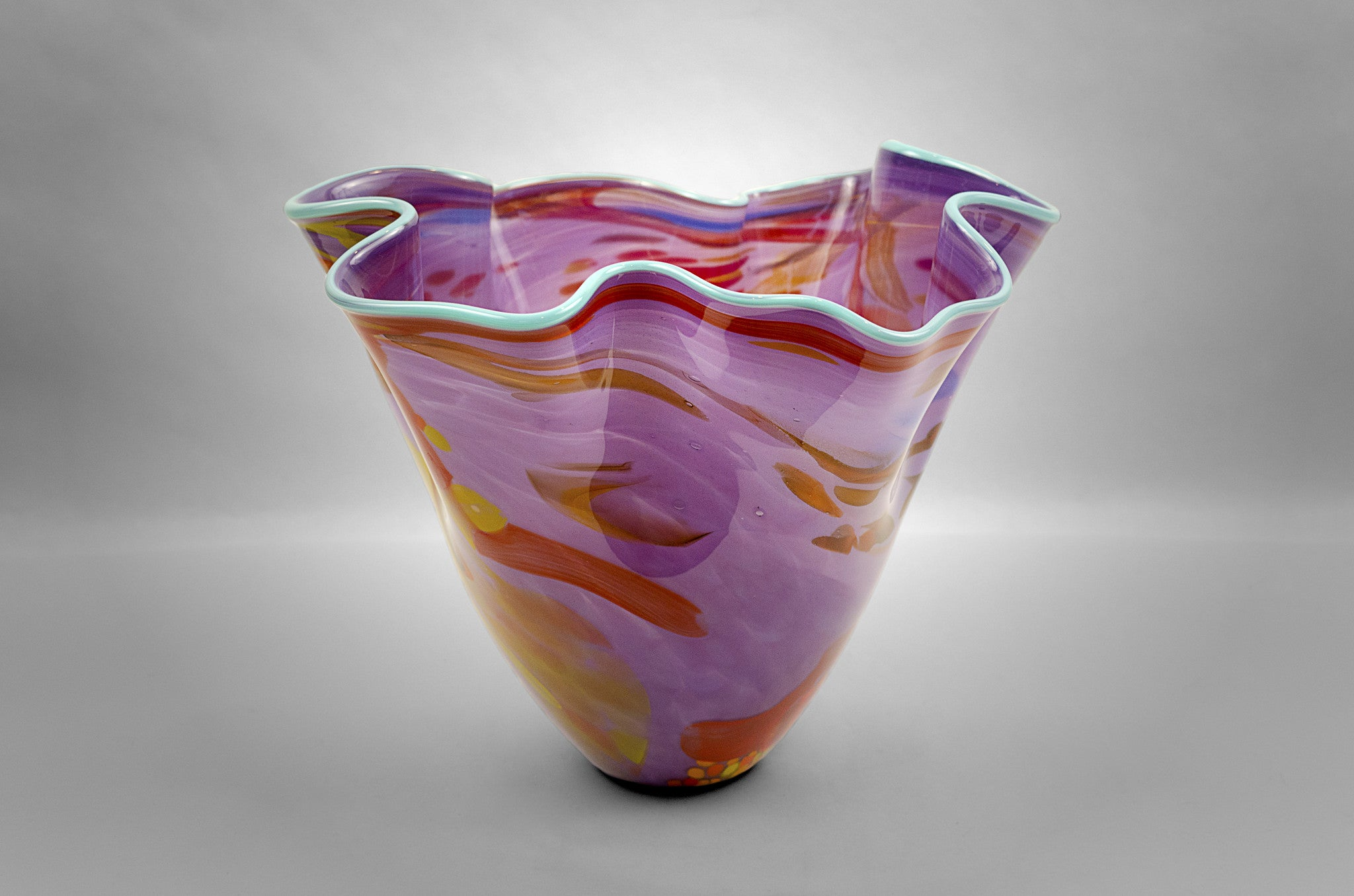 Fluted bowl / vase with broken shards of recycled glass and purple base color and light blue rim
