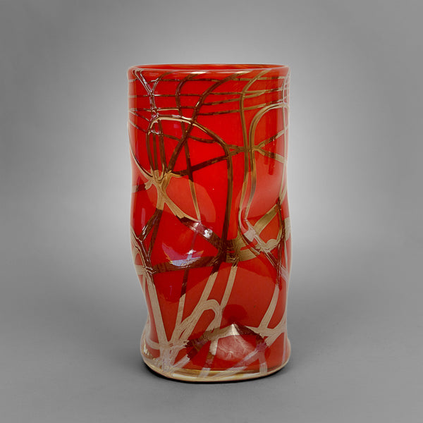 Red Picasso drinking glass with silver swirls