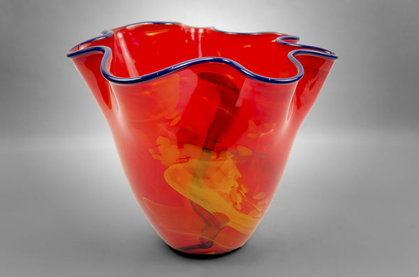 Fluted bowl / vase with broken shards of recycled glass and red base color and blue rim