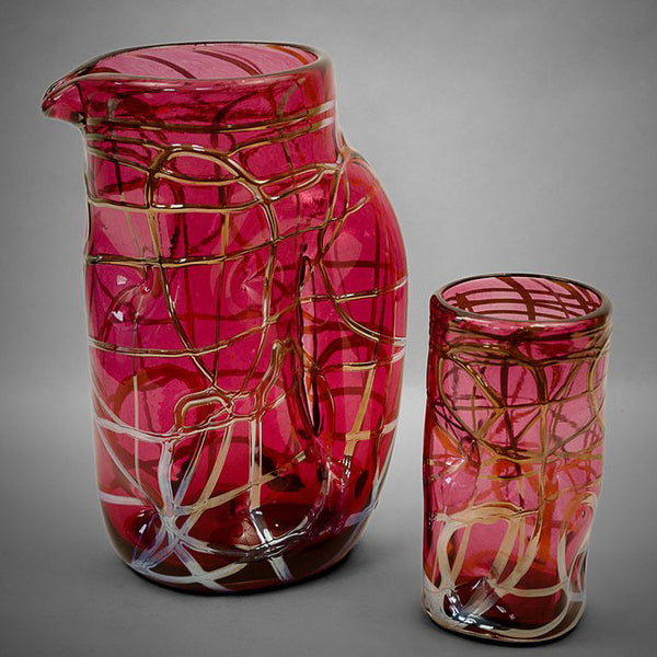 Ruby Picasso drinking glass and pitcher with silver swirls