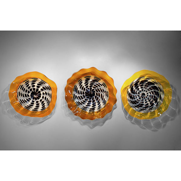Clear and black spotted wall platters in light orange rim (left), gold topaz rim (center), or light yellow rim (right) in various sizes