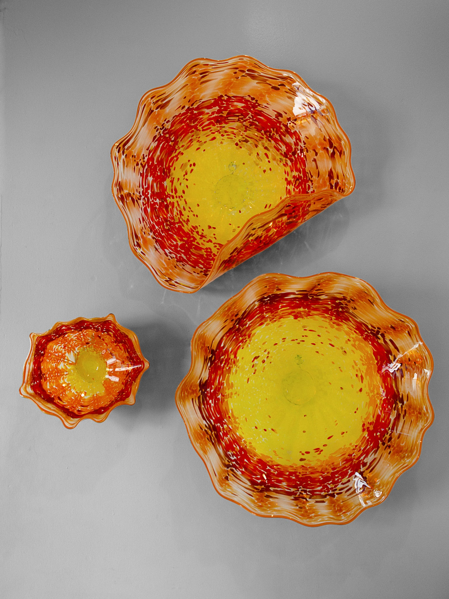 Wall platter collection in various sizes with yellow, orange and red colors
