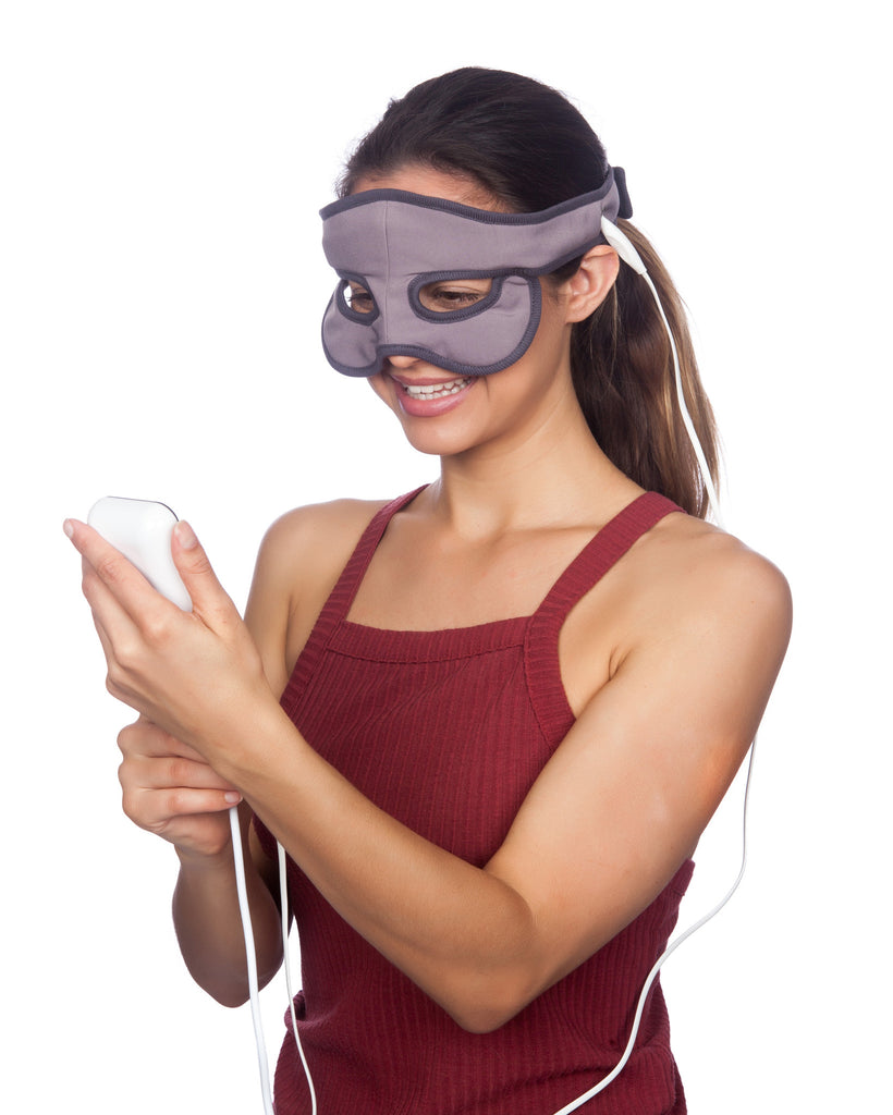 Womand using Sniff Relief USB Mask & holding temperature controller