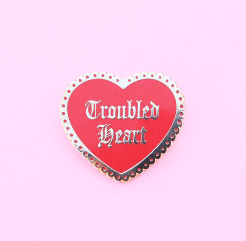 Troubled heart enamel pin