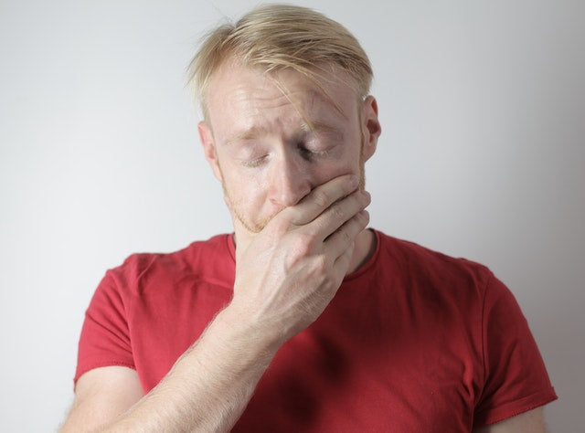 Man dealing with tooth injury as one of the toothache symptoms