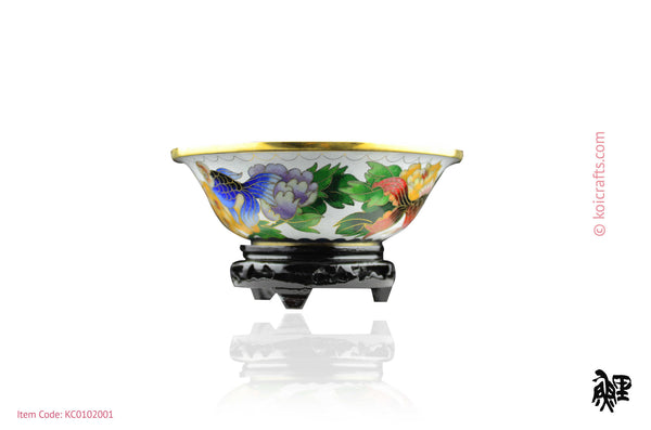 Small goldfish cloisonne bowl in white background.