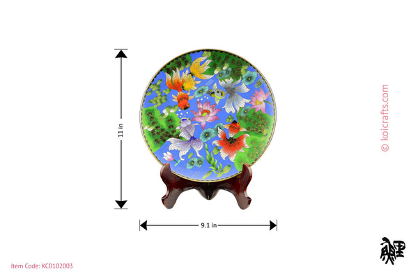 Round gold fish cloisonne plate in blue background