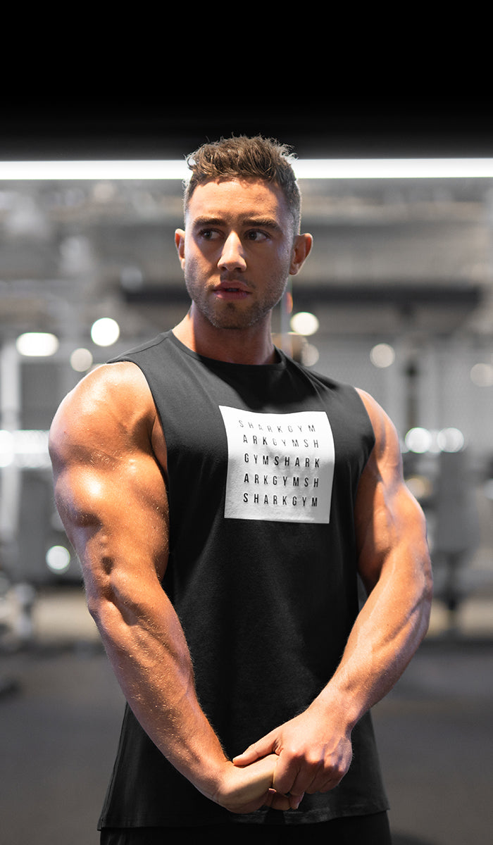 Gymshark athlete Zac Perna flexing tricep in contour lighting in the Gym.