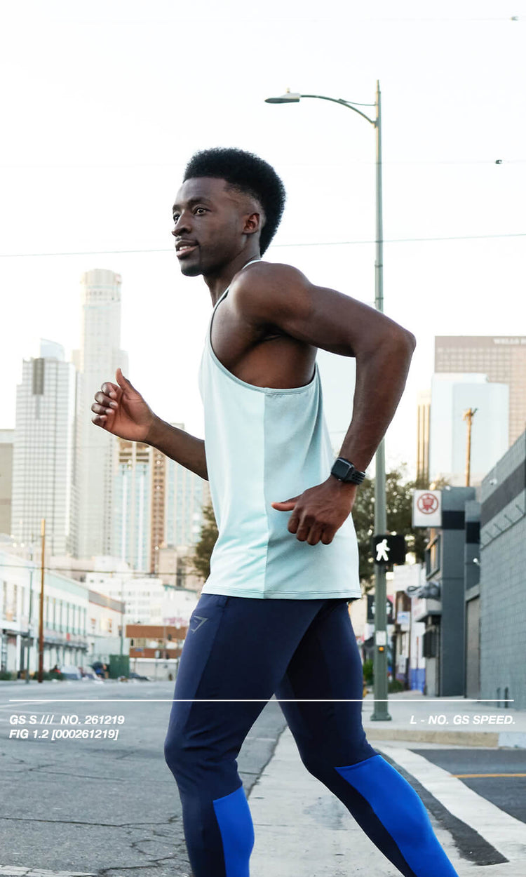 Male model stepping into the road mid run wearing the Gymshark Speed Collection.