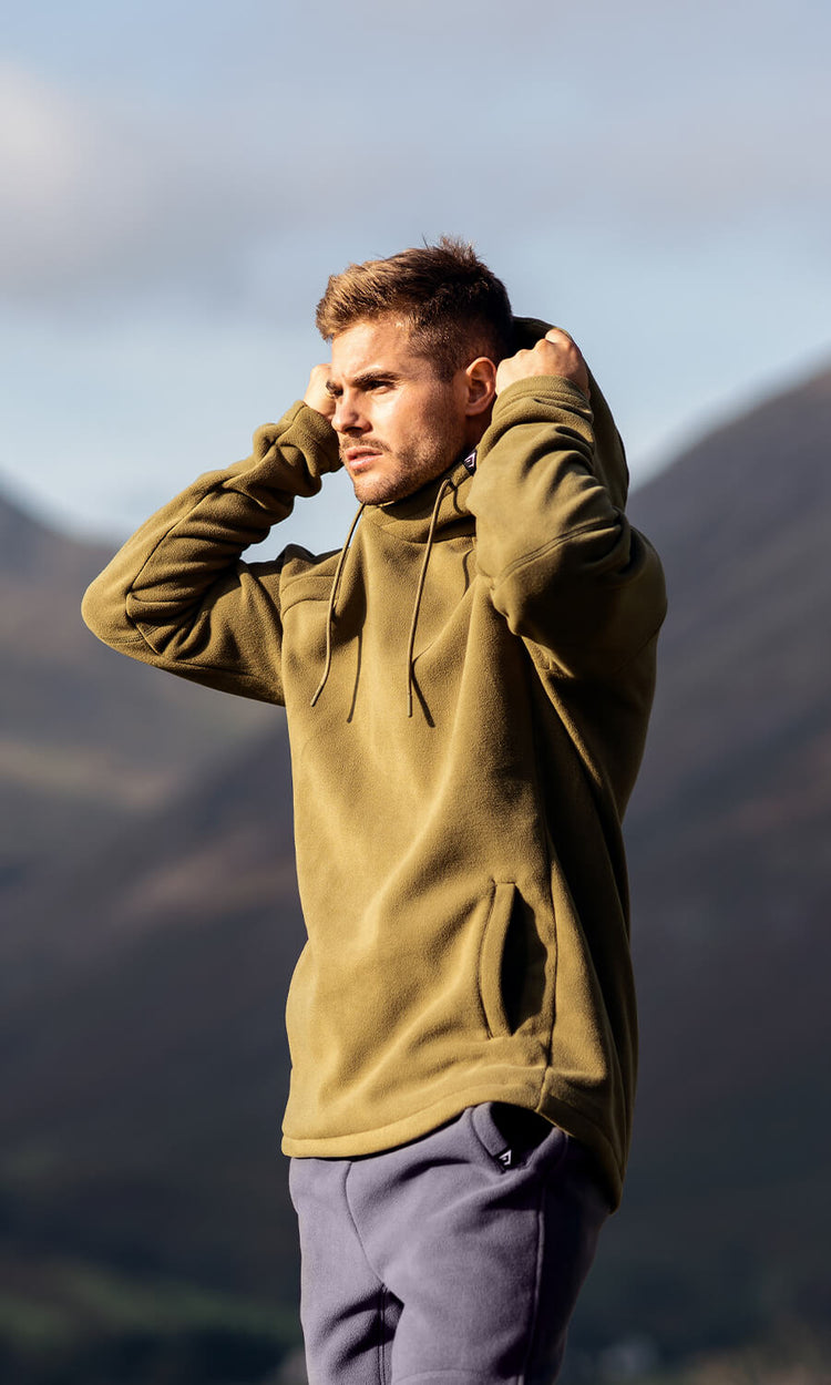 Gymshark athlete modelling outerwear in front of a scenic back drop of Lake District.