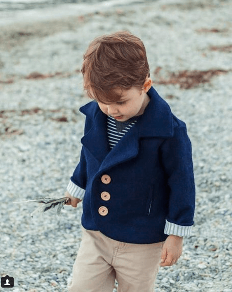 boy in country coat, pure nz wool