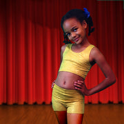 Girl dancing in Aurelia's gold bubbles dancewear costume bra top and shorts - by UraMermaid.com
