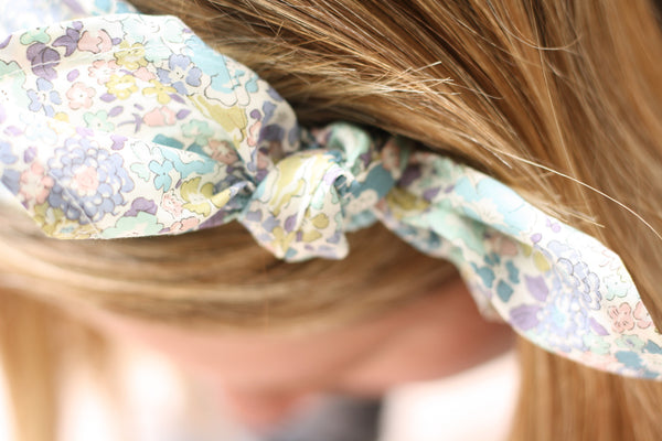The Country Highlights Collection gift box for new and expectant mums contains this Liberty Print headscarf. Available from Wonder of Kin - Curating Independent Brands.