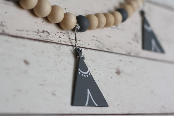 Little Bird Designs teepee nursery garland from The Ovi and Reu Country Collection gift box for new mums and babies. Available from Wonder of Kin - Curating Independent Brands.