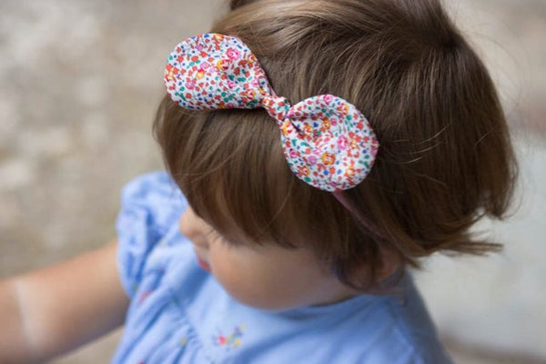 Liberty Dainty Floral Head Band with Bow. Handmade in Somerset by Runaround Retro and available from Wonder of Kin, these head bands are the perfect gift for a little girl or even a tiny baby as they really are so soft. The ideal vintage style gift for children to style up any outfit with a bit of retro floral love!