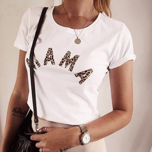 White t-shirt with MAMA written on the front in leopard print. Made to order by Whoopsie Daisie available at Wonder of Kin - curating indie brands.