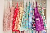 Mini Pinny for children learning to cook. Selection of full skirted pines in various bright colours.