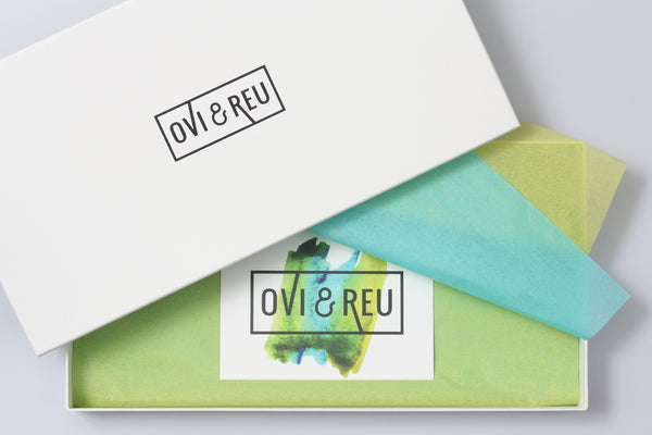 Letterbox friendly Ovi and Reu gift box packaging presents for new and expectant mums and babies. Available from Wonder of Kin - Curating Independent Brands.