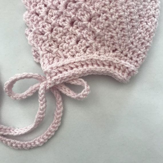 Sakura bonnet by Esme Grace. Crocheted bonnet for children available in a beautiful range of colours. The perfect newborn gift or christening present. Heirloom pieces available at Wonder of Kin.