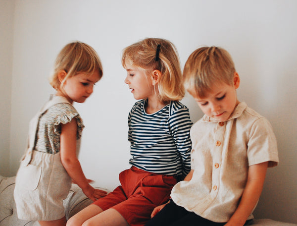 Pale linen striped short sleeve shirt with wooden buttons down the front. Perfect for a relaxed, casual, vintage feel for your children's wardrobe. Available from Wonder of Kin - Curating Independent Brands.