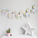 Pastel coloured unicorn garland from House of Hooray available at Wonder of Kin - Curating independent brands