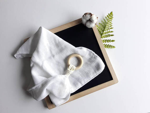 Vanilla white muslin square with baby safe wooden ring by Pure Cotton Studio available from Wonder of Kin