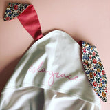 Personalised bunny ear blanket with Liberty print ears. Available at Wonder of Kin - Curating Indie Brands,