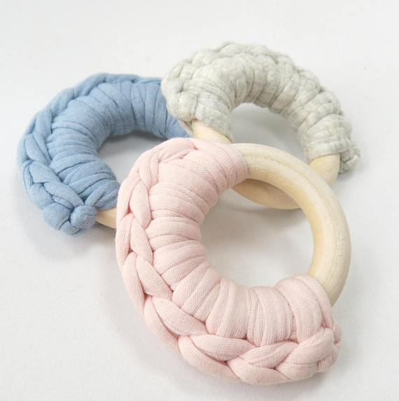 Beautiful wooden teethers with soft pastel crochet decoration by Eva loves Oli at Wonder of Kin - Curating Independent Brands.