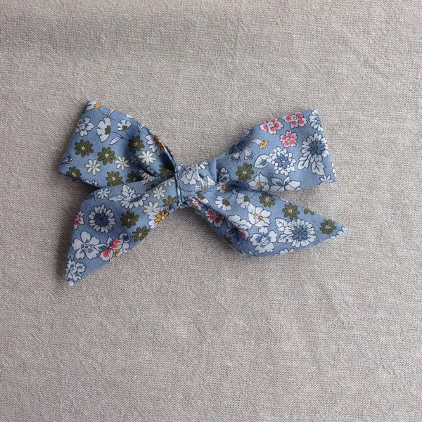 Floral school girl style hair bow on metal clip. Perfect gift for a little girl to add some vintage style to any outfit. Handmade in Somerset by Runaround Retro and available from Wonder of Kin.