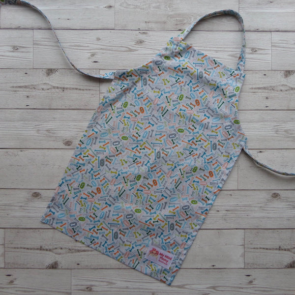 Aprons designed for children by British designer and maker My Mini Pinny. Handmade gift for kids who like baking. Available now from Wonder of Kin - Curating Independent Brands.