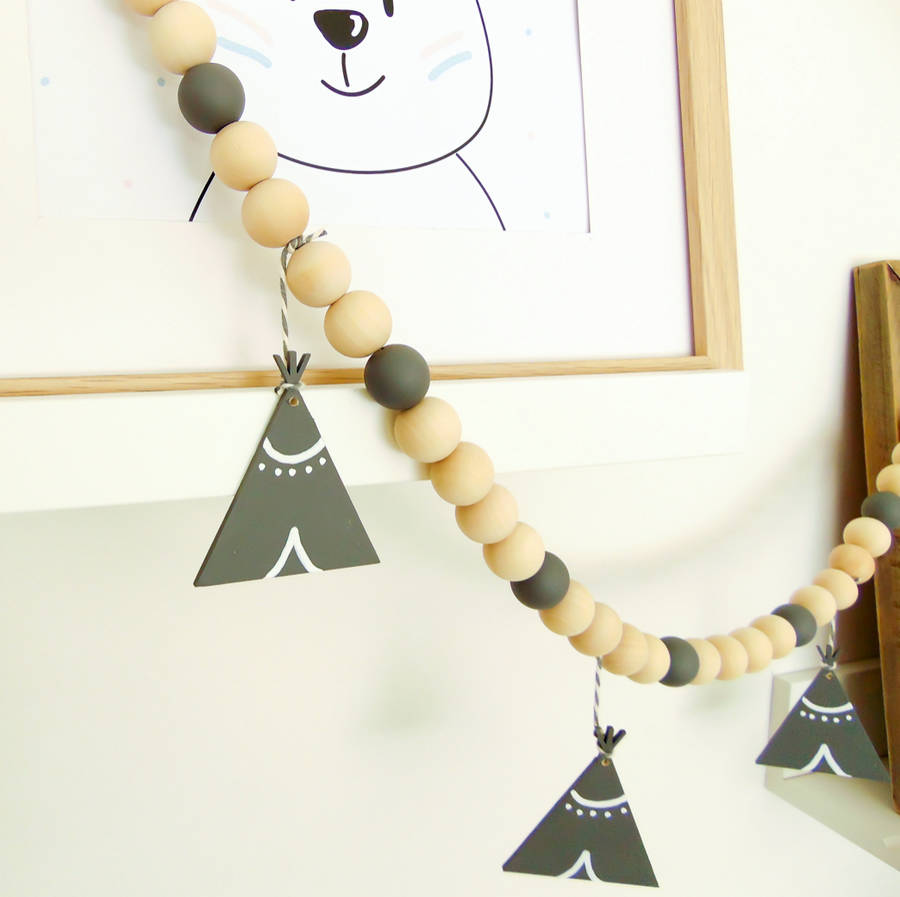 Wooden teepee nursery garland from Little Bird Designs. Available from Wonder of Kin - Curating Independent Brands.