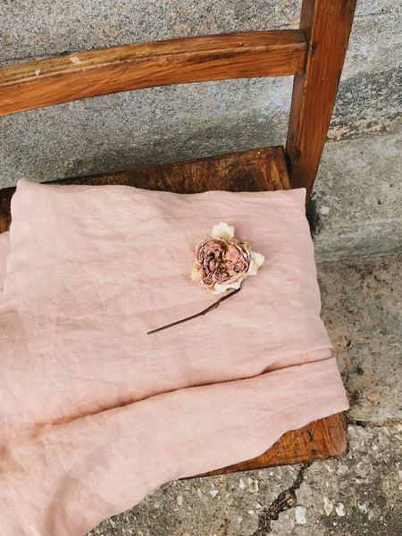 Hand dyed pink linen close up Pink hand dyed laundered linen pleated front dress by The Old Rectory Clothing Company available exclusively at Wonder of Kin - curating indie brands