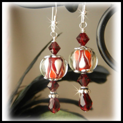 Red and white lampwork glass earrings with Siam Swarovski crystals.